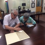 Assemblyman Steven Englebright and Maria Hoffman examining letter in Special Collections.