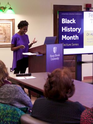 Dr. Abena Ampofoa Asare giving a lecture during the Black History Month Lecture Series