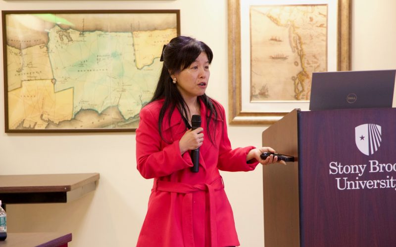 Wendy Tang presenting on the present state of women in STEM, in honor of Women's History Month