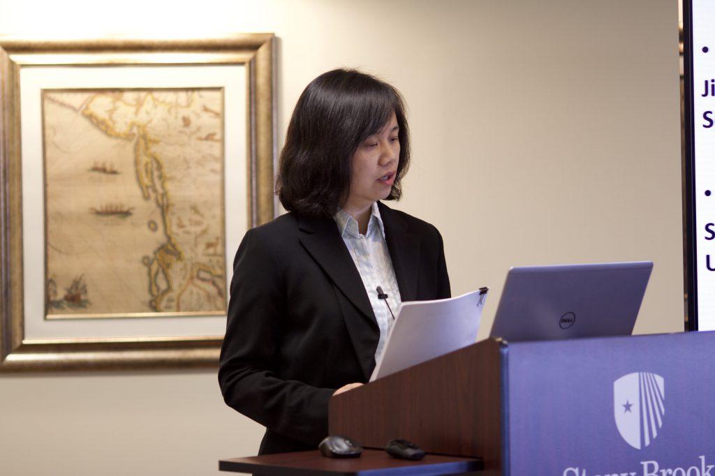 Ms. Qian Xu lecturing
