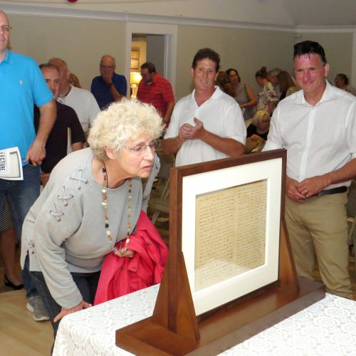 Attendees viewing 1779 letter. Washington lecture and letter viewing, Neighborhood House, Setauket, July 16, 2018. Photo credit: Beverly C. Tyler.