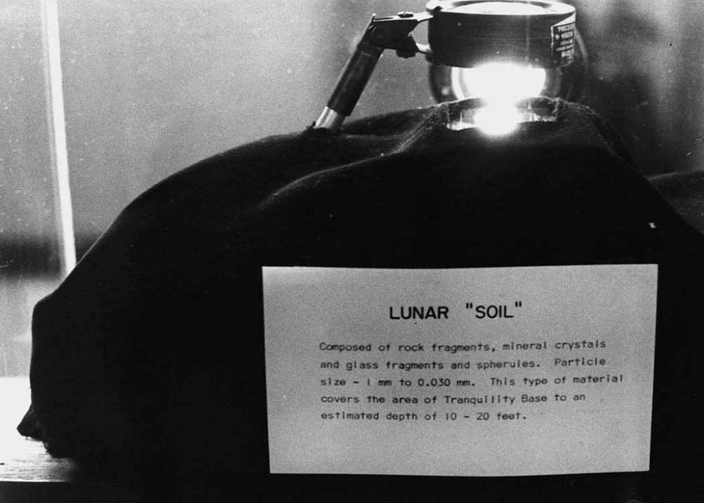 "Lunar ""Soil"" collected during the Apollo 11 spaceflight to the Moon in July 1969 was displayed in the Earth and Space Sciences building on October 19, 1972. Photograph from the University Archives, Stony Brook University Libraries."