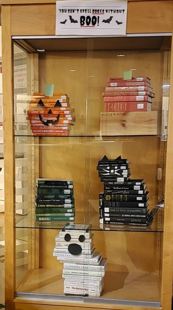 Halloween figures made out of stacked books