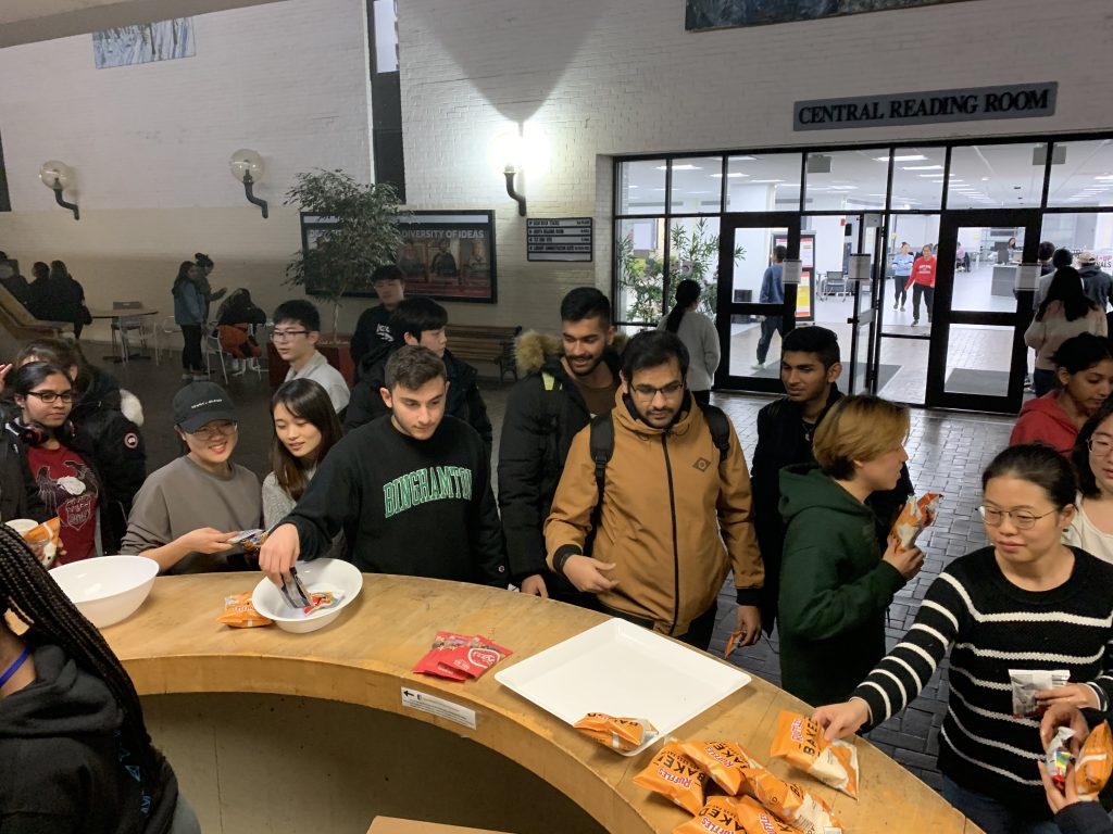 students collecting snacks