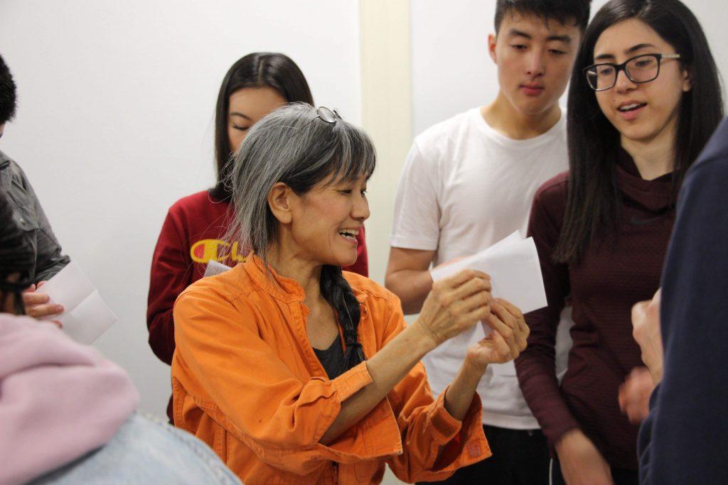 Prof. Nagasawa holding paper