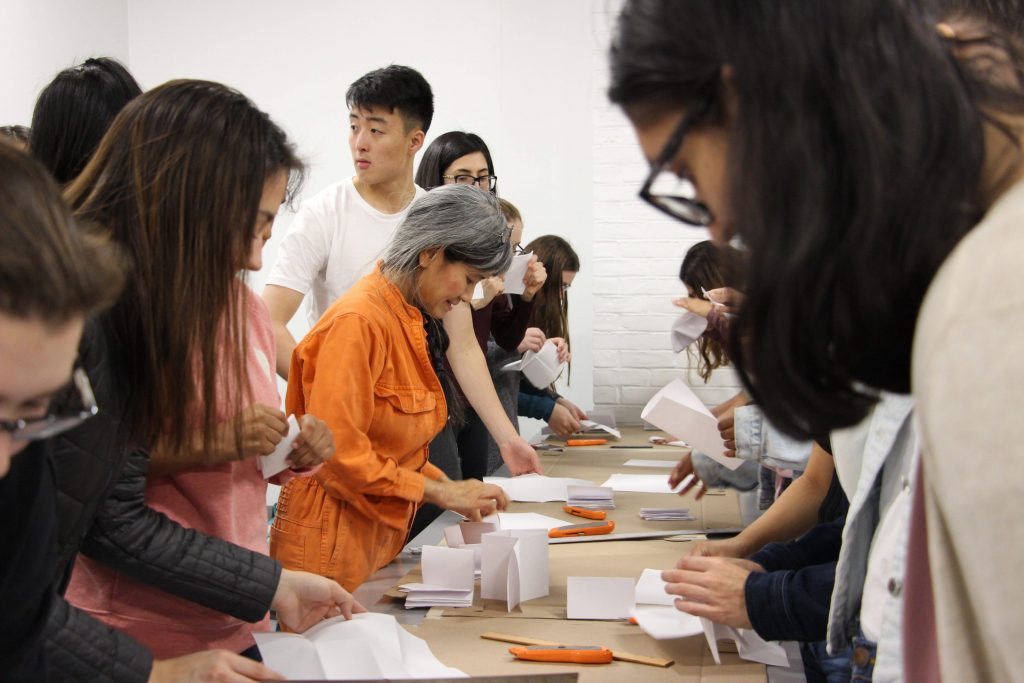 students at work on long table