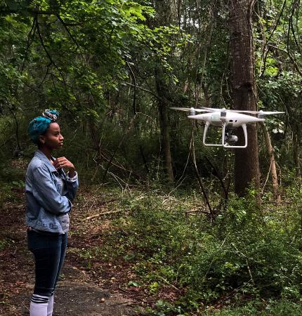 Stony Brook junior Kiara Thomas with drone. Photo by Joshua Joseph.