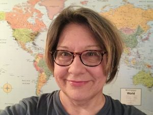Picture of Diane Englot in front of world map