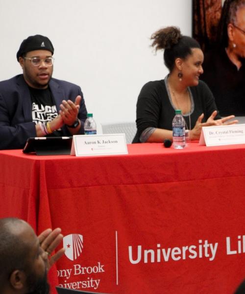 People on panel speaking