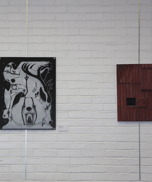 Two pieces of student artwork at Art Show