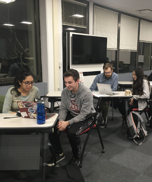Students at the writing center in the library
