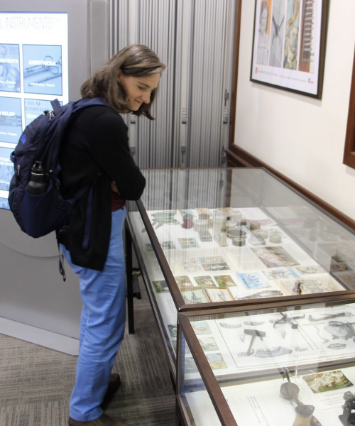 Person looking at things on display at the Prelec Memorial Lecture