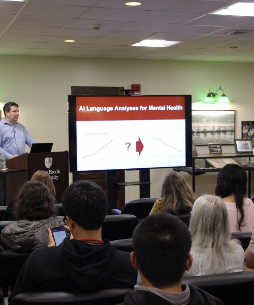 Dr. H. Andrew Schwartz presenting to students