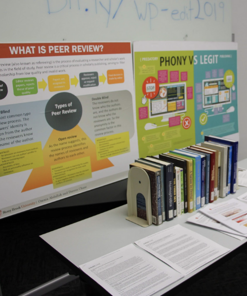 Poster boards and books on display for the Editathon