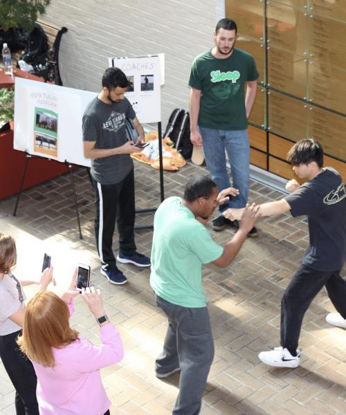 Martial arts club members demonstrating in Melville galleria