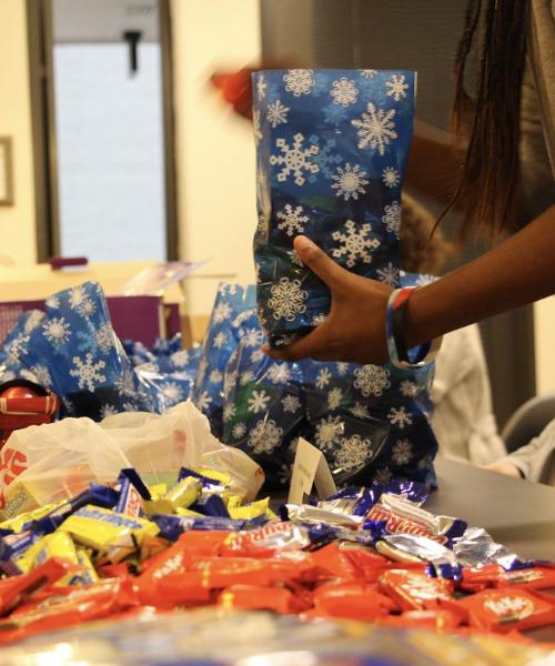 Student staff member making goodie bags