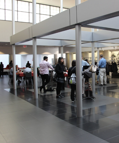 Lobby of people at Open Access Symposium