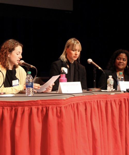 Women on panel speaking at Open Access Symposium